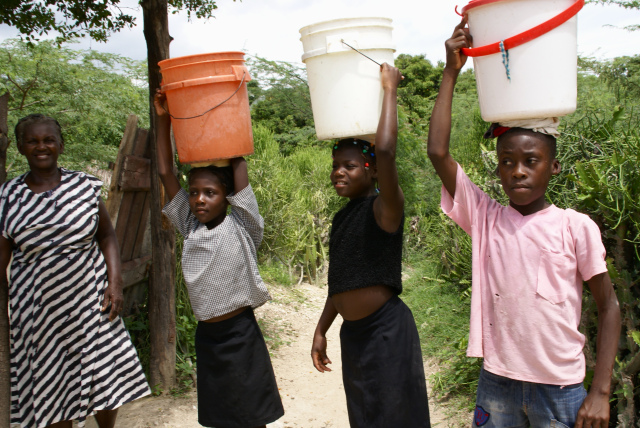 haitian girls carrying water