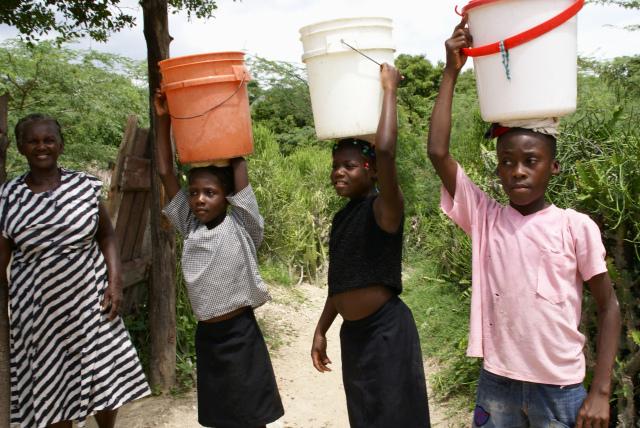 haitian girls carrying water
