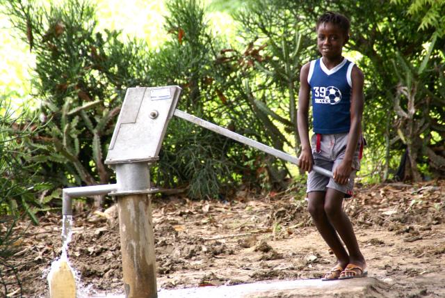 haitian girl at water pump