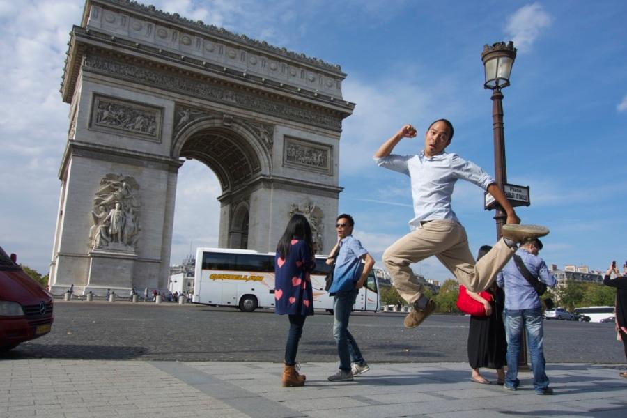 Jumping Jedd, Arc de Triomphe, Paris | Intentional Travelers